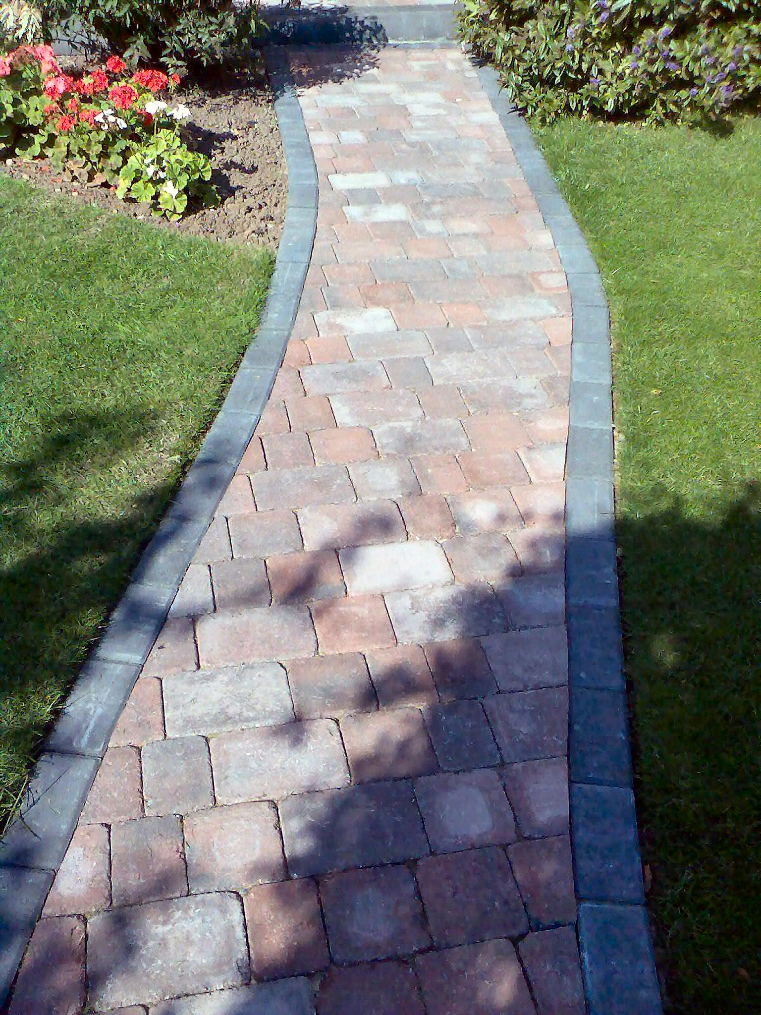 Garden design abacus landscaping design for Paved front garden designs