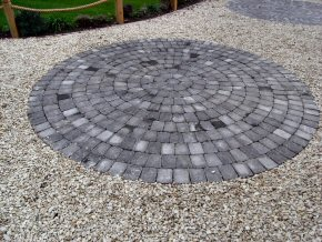 Granite set rotund in driveway with a gravel surround, edged by a post and rope trip fence in Watchet