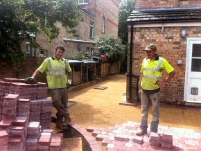 Laying block pavers.