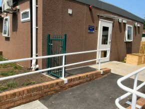 Disabled ramp formed to classroom. Installation of handrails and retaining walls formed.