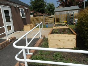 Disabled access formed. Planter and storage boxes formed in the garden.